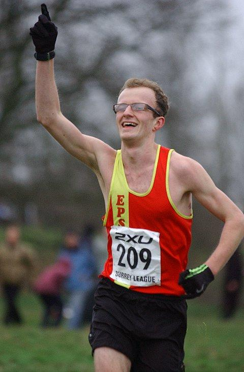 First man home: Ollie Garrod celebrates crossing the line first in the Surrey League Divsion Two meeting on Mitcham Common    SP73251