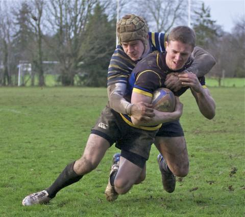 Pulled up short: Old Walcountians' Ross Norton is tackled just short of the white line    Picture: Alun Stockton