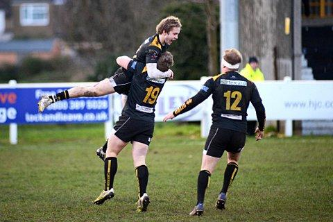You beauty: Esher's Harlequins academy winger Charlie Walker celebrates his game clinching score against Blaydon