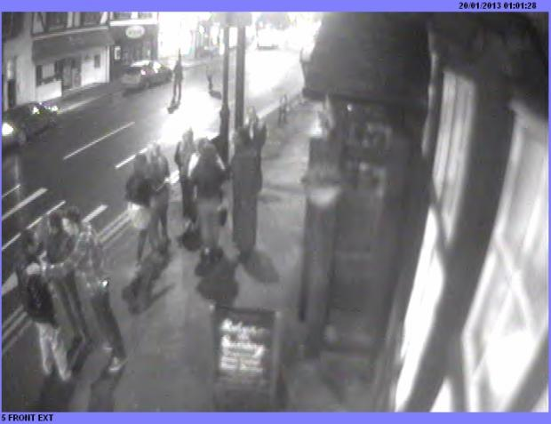 Police want to speak to the man in white trousers on the far left of the image