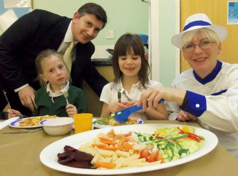 Foresters Primary School headteacher Havard Spring serves lunch to well-mannered youngsters