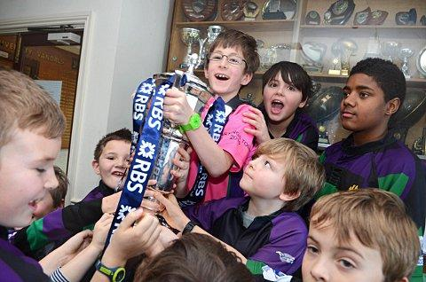Living the dream: Weybridge Vandals youngsters lift the Six Nations trophy on Thursday