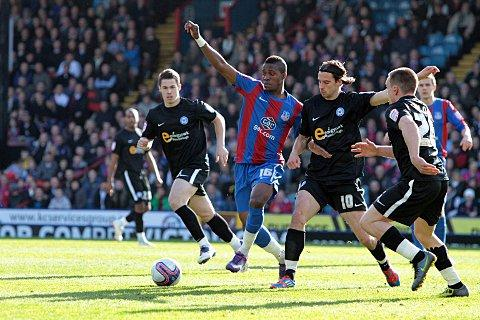 George Boyd (right) challenges Wilfried Zaha when Posh visited Selhurst last season