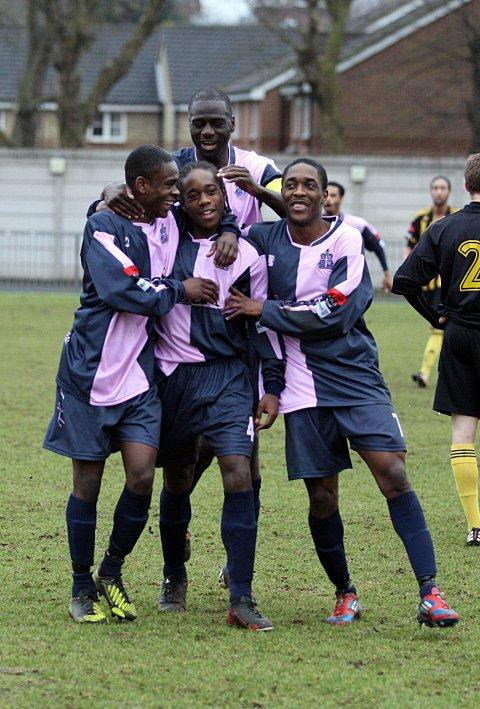 Celebrate good times: Xavier Vidal is mobbed after scoring for Hamlet against Dulwich    SP72946