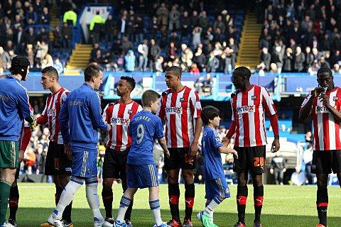 Not here to make up the numbers: Brentford and Chelsea greet each other ahead of the FA Cup replay on Sunday        SP74039