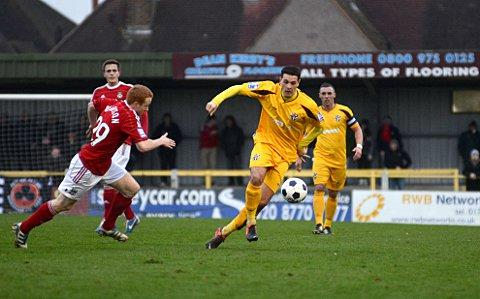 New boy: Tommy Kavanagh, right, in action for Sutton United against Blue Square Premier leaders Wrexham in the FA Trophy