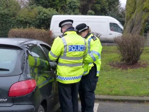 Officers stop a car during Operation Big Wing