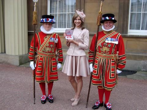 Joanna Rowsell with her MBE at Buckingham Palace