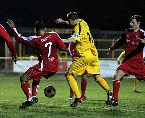 You Beauty: Harry Beautyman is about to score the winning goal on a thrilling night at Gander Green Lane     Picture: Paul Loughlin