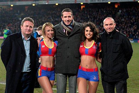 Fledgling Eagle: Mark Smith, middle, with Palace co-chairman Steve Browett, left, academy manager Gary Issott, right, and two Crystal Girls. Courtesy: Crystal Palace Football Club