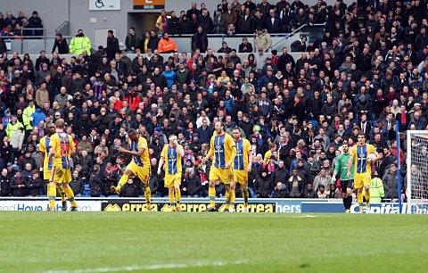 Disappointing day: Unhappy Palace players and fans at Brighton on Sunday