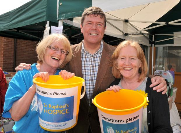Paul Burstow, a long-term supporter of St Raphael's Hospice, celebrating this year's fete with fundraisers
