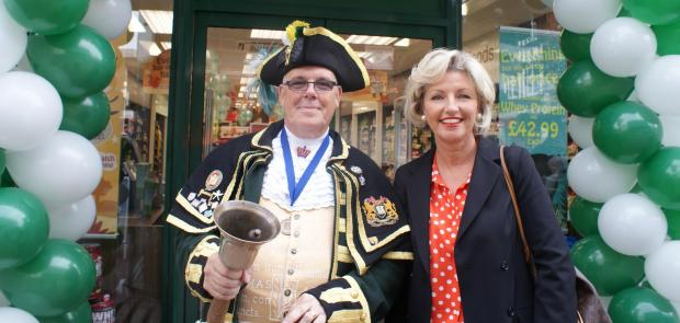 Sutton Guardian: Town Crier Anthony Church and Mandy Cherrington outside the new store