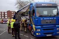 Sutton Guardian: Emergency services survey the damage to the lorry Deadlinepix KT12844