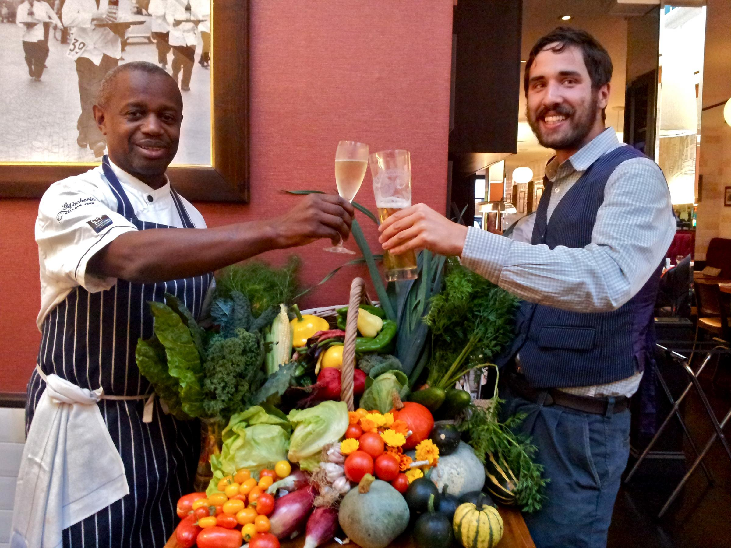 Sutton Community Farm's head grower Joris Gunawardena (right) with Brasserie Vacherin chef Malcolm John at a fundraising event