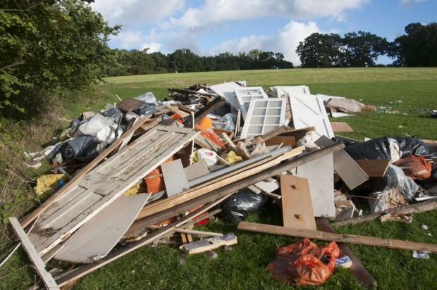 Sutton Guardian: Travellers leave Rose Hill Park leaving mountains of rubbish