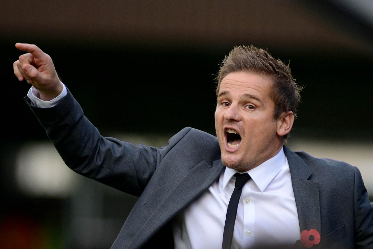 Unhappy: Neal Ardley was saddened by his team's performance in the 3-0 defeat against Rochdale        SP79028