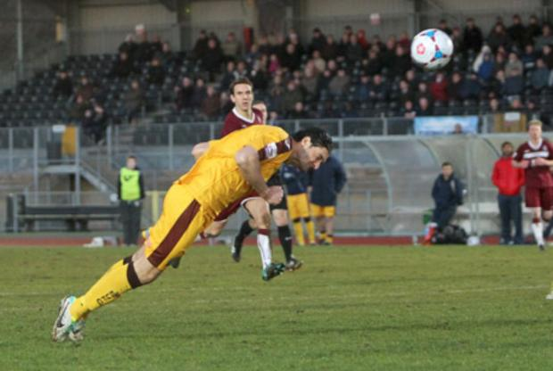 BOOM: Jamie Slabber heads Sutton United ahead at Chelmsford City              All pictures: Paul Loughlin