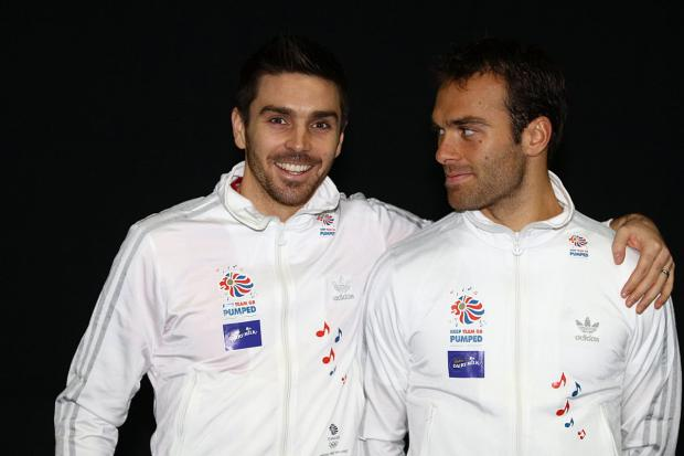 Back together: Ross Hutchins, right, and Colin Fleming are through to the second round of the Australian Open