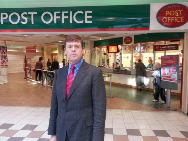 Paul Burstow MP for Sutton and Cheam outside the post office