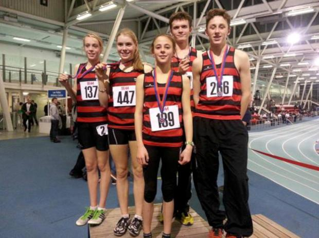 Sutton Guardian: The heroes of Herne Hill Harriers: Eloise O'Shaughnessy, Skye O'Shaughnessy, Zoe Tompkins, Ed Olsen, Billy Black at the South of England Athletic Association Indoor Championships