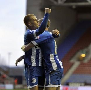 Ben Watson, left, celebrates his strike with fellow goalscorer James McClean