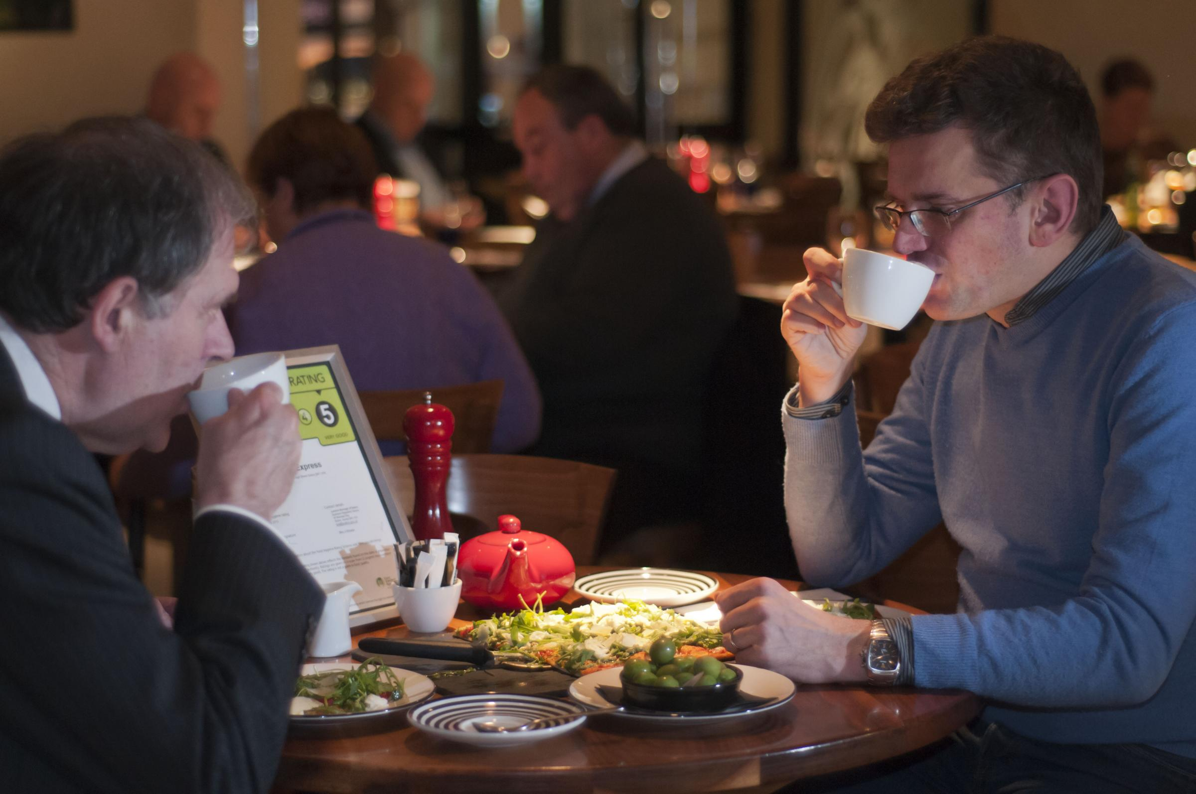 Councillor Richard Clifton (left) enjoys a spot of lunch with Pizza Express Sutton manager Zack Tuznik