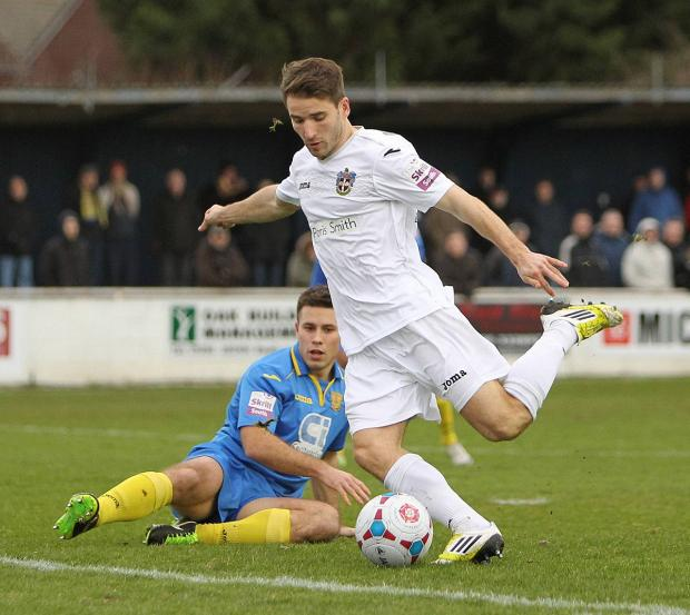 Not this time: Jamie Taylor's effort is blocked, but the striker soon found the back of the net in the 1-0 win over Basingstoke            Picture:  Paul Loughlin