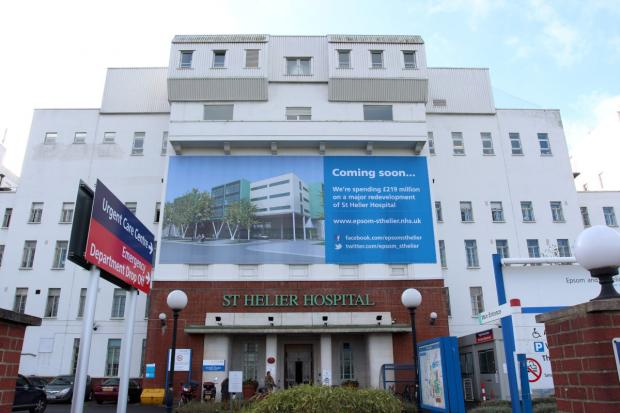 Sutton Guardian: A banner still adorns St Helier Hospital saying the redevelopment is 'coming soon'