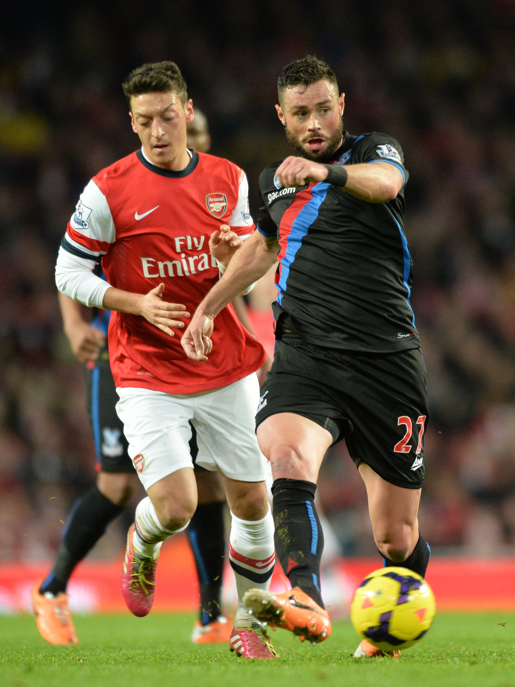 Sutton Guardian: The Eagles defender gets the better of German star Mesut Ozil at the Emirates. PICTURE BY KEITH GILLARD.