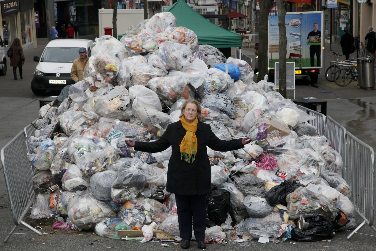 Council leader Ruth Dombey in front of Sutton's rubbish mountain