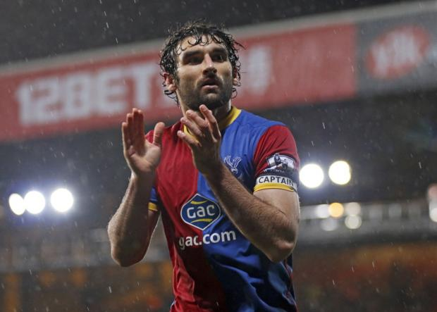 All in it together: Mile Jedinak is loving the team ethic in the Palace camp