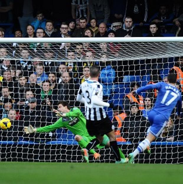 Sutton Guardian: Eden Hazard scores the first of his hat-trick against Newcastle