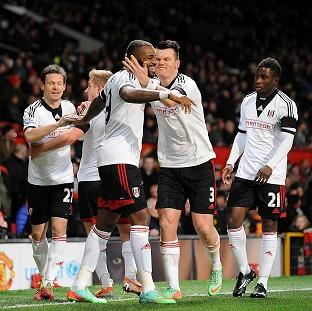 Sutton Guardian: Darren Bent, centre, is mobbed by his team-mates after netting the equaliser