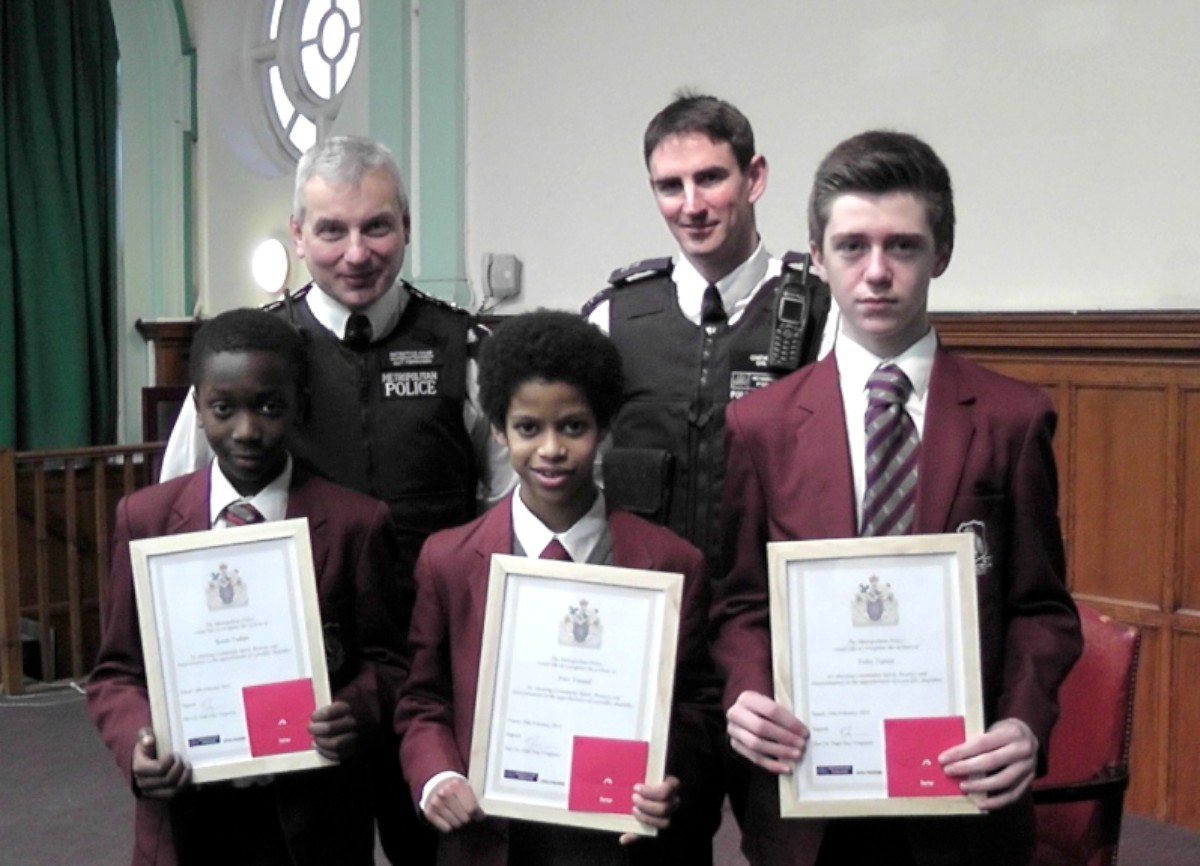 Borough Commander Guy Ferguson and PC Dave Earl with, from left: Kunle Fadipe, Faiz Yuusuf and Felix Turner. Midu Loganathan was unavailable for the presentation.