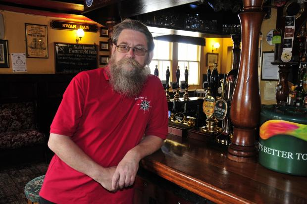 Sutton Guardian: Rodger Molyneux at the bar in the Hope