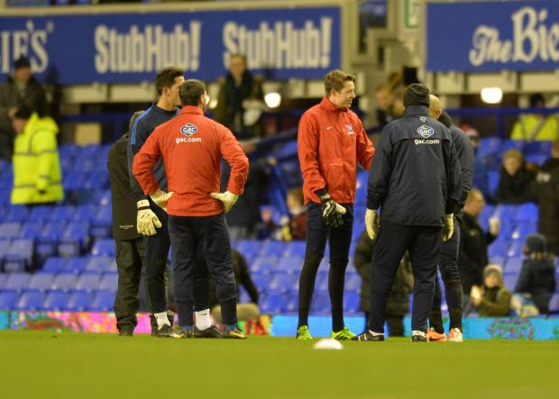 Sutton Guardian: Palace players warm up before the game was cancelled