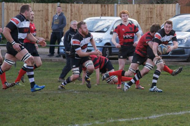 Here: James Caddy offloads to Shawn Renwick for his second try of the afternoon                      All pictures: Dave Jackson