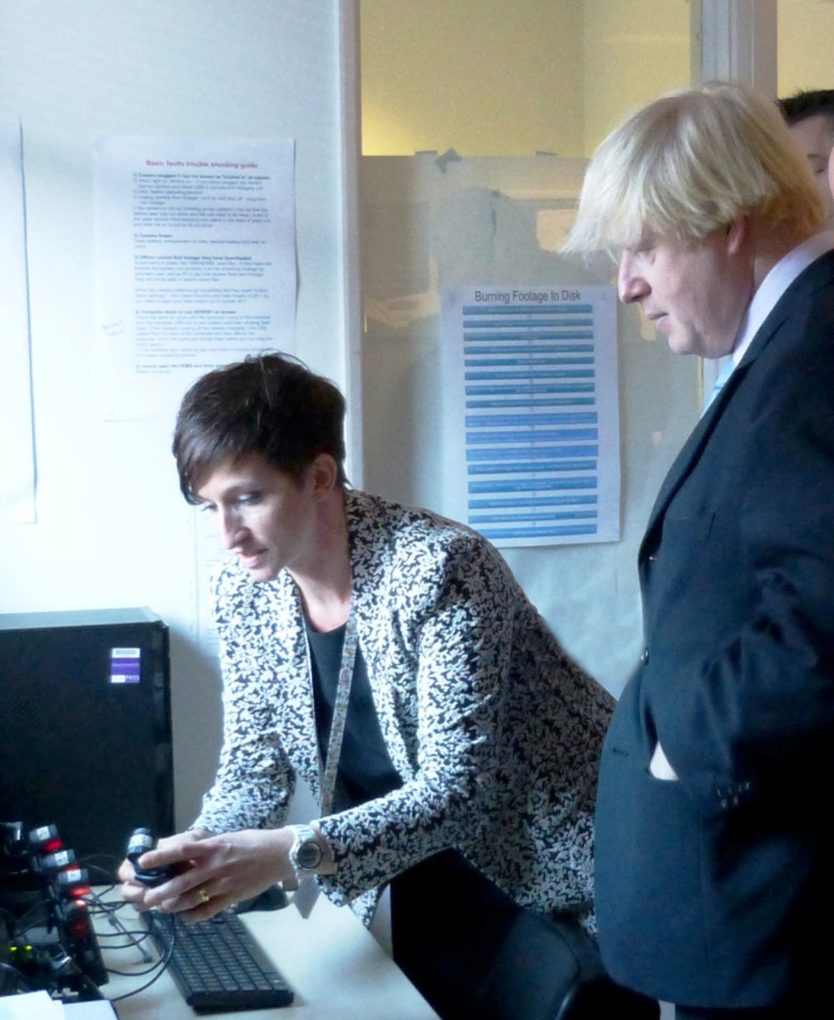 PC Washington tells London Mayor Boris Johnson about the body cameras during a visit last year