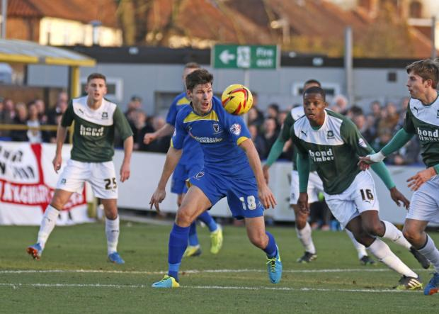 Proving his worth: Charlie Sheringham has earned praise off Dons boss Neal Ardley