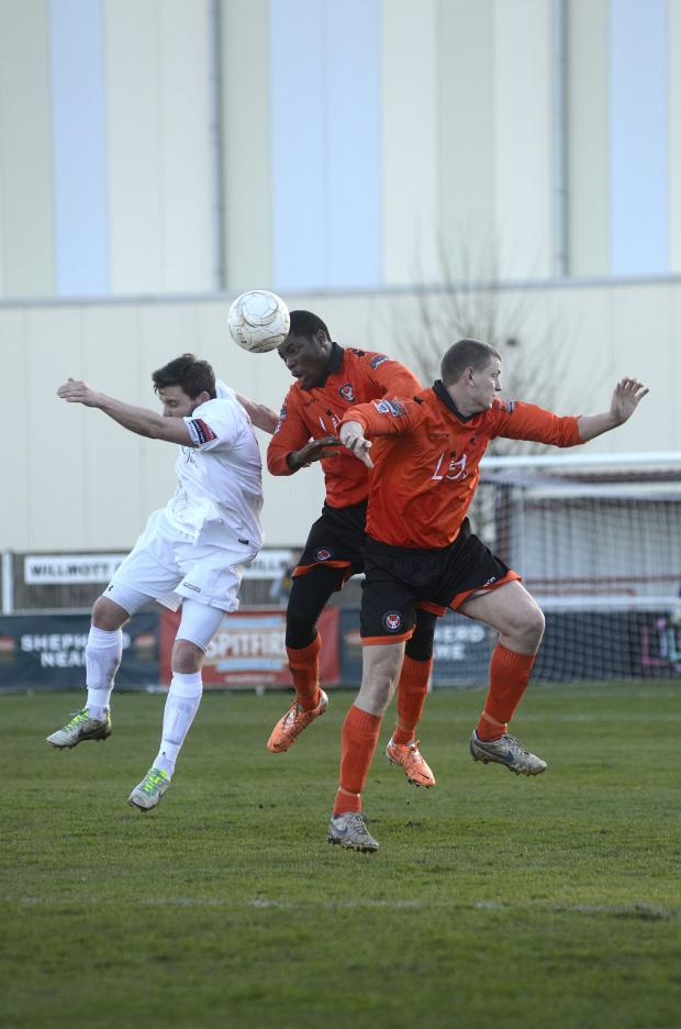 Sutton Guardian: Involved: Walton Casuals' Jamal Jimoh gets in the act