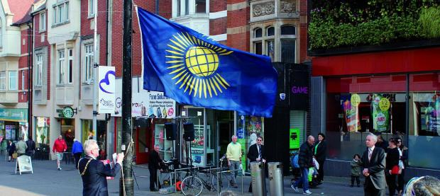 Sutton Guardian: The mayor Councillor Sean Brennan raised the flag of the Commonwealth this morning