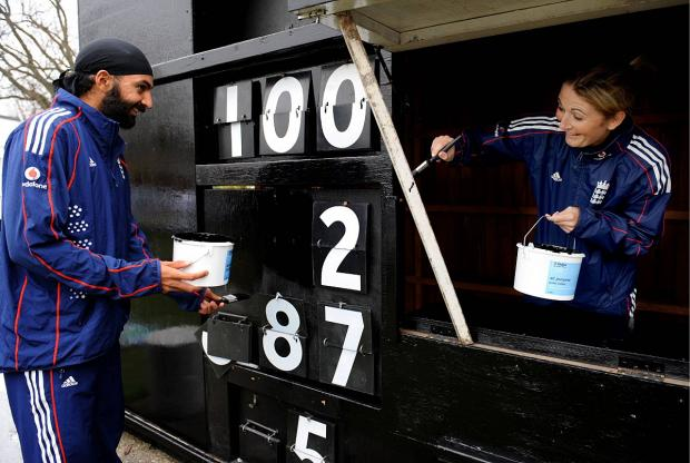 Mucking in: Monty Panesar and Rachel Edwards get stuck at Ashtead CC in 2009
