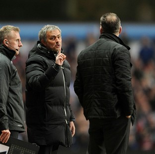 Jose Mourinho, centre, was sent to the stands late on at Villa Park