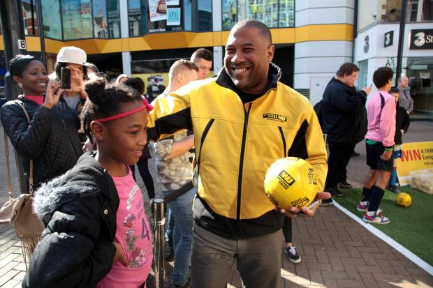 All smiles: John Barnes meets a fan