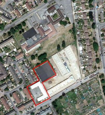 The planned site for the houses is outlined in red (picture: Google)