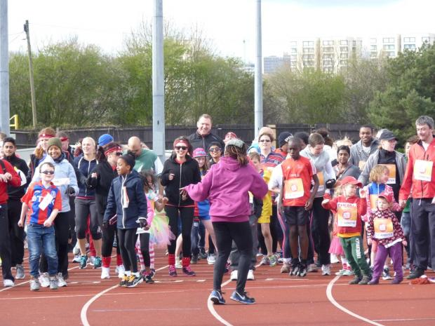 On your marks: Runners prepare for the Sport Relief mile at Croydon Arena on Sunday