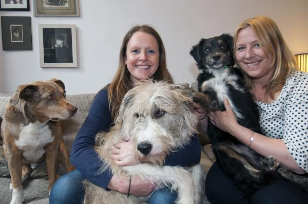 Jennifer Gilbert and Lisa Webster with their own dogs in the UK