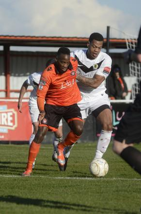 Going nowhere: Walton Casuals striker Gabriel Odunaike is staying put - for now