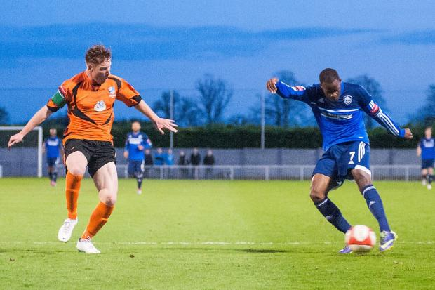 Sutton Guardian: Shoot on sight: Former Arsenal trainee and Jamaican international Nigel Neita takes a shot in Tuesday's 3-0 London Senior Cup semi-final triumph over Wingate & Finchley at Imber Court	 	Deadlinepix SP83420